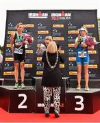 9 August 2015; Susie Cheetham, Great Britain, is congratulated by Lord Mayor of Dublin Críona Ní Dhálaigh,  with second place Samantha Warriner, left, New Zealand, and third place Sonja Tajisich, Germany, after fighting off stiff competition to take the gold medal at today's inaugural IRONMAN 70.3 Dublin. Dublin City Council hosted the competition which saw over 2500 athletes complete a 1.2 mile swim in Scotsman's Bay in Dun Laoghaire, before mounting their bikes to travel through Dublin and west of the city for a 56 mile cycle, to return to the Phoenix Park for the 13.1 mile half-marathon.    1,500 Irish athletes took part in today's event and 1,000 international athletes from 40 countries travelled to Dublin to compete in the gruelling competition. Chesterfield Avenue, Phoenix Park, Dublin. Picture credit: David Maher / SPORTSFILE