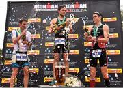 9 August 2015; Denis Chevrot, France, centre, fought off stiff competition to take the gold medal at today's inaugural IRONMAN 70.3 Dublin from second place,   Markus Thomschke, left, Germany and third place, Kevin Thornton, Ireland. Dublin City Council hosted the competition which saw over 2500 athletes complete a 1.2 mile swim in Scotsman's Bay in Dun Laoghaire, before mounting their bikes to travel through Dublin and west of the city for a 56 mile cycle, to return to the Phoenix Park for the 13.1 mile half-marathon.    1,500 Irish athletes took part in today's event and 1,000 international athletes from 40 countries travelled to Dublin to compete in the gruelling competition. Chesterfield Avenue, Phoenix Park, Dublin. Picture credit: David Maher / SPORTSFILE