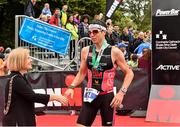 9 August 2015; Kevin Thornton, Ireland, who finished in third place, is congratulated by Lord Mayor of Dublin Críona Ní Dhálaigh, at today's inaugural IRONMAN 70.3 Dublin. Dublin City Council hosted the competition which saw over 2500 athletes complete a 1.2 mile swim in Scotsman's Bay in Dun Laoghaire, before mounting their bikes to travel through Dublin and west of the city for a 56 mile cycle, to return to the Phoenix Park for the 13.1 mile half-marathon.    1,500 Irish athletes took part in today's event and 1,000 international athletes from 40 countries travelled to Dublin to compete in the gruelling competition. Chesterfield Avenue, Phoenix Park, Dublin. Picture credit: David Maher / SPORTSFILE