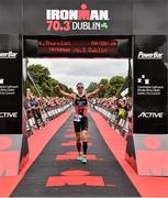 9 August 2015; Kevin Thornton, Ireland, celebrates after finishing third at today's inaugural IRONMAN 70.3 Dublin. Dublin City Council hosted the competition which saw over 2500 athletes complete a 1.2 mile swim in Scotsman's Bay in Dun Laoghaire, before mounting their bikes to travel through Dublin and west of the city for a 56 mile cycle, to return to the Phoenix Park for the 13.1 mile half-marathon.    1,500 Irish athletes took part in today's event and 1,000 international athletes from 40 countries travelled to Dublin to compete in the gruelling competition. Chesterfield Avenue, Phoenix Park, Dublin. Picture credit: David Maher / SPORTSFILE