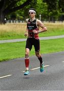 9 August 2015; Kevin Thornton, Ireland, during today's inaugural IRONMAN 70.3 Dublin. Dublin City Council hosted the competition which saw over 2500 athletes complete a 1.2 mile swim in Scotsman's Bay in Dun Laoghaire, before mounting their bikes to travel through Dublin and west of the city for a 56 mile cycle, to return to the Phoenix Park for the 13.1 mile half-marathon.    1,500 Irish athletes took part in today's event and 1,000 international athletes from 40 countries travelled to Dublin to compete in the gruelling competition. Chesterfield Avenue, Phoenix Park, Dublin. Picture credit: David Maher / SPORTSFILE