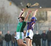 4 January 2009; Michael Fitzgerald, Limerick, in action against Jim Bob McCarthy, University Limerick. Waterford Crystal Cup, Limerick v University Limerick, Claughaun GAA Club, Claughaun, Limerick. Picture credit: Pat Murphy / SPORTSFILE