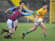 4 January 2009; Emlyn Mulligan, Leitrim, in action against Paul McGimley and Colin Canney, GMIT. FBD Connacht League, Section 2, GMIT v Leitrim, Tuam Stadium, Tuam, Co. Galway. Picture credit: Ray Ryan / SPORTSFILE