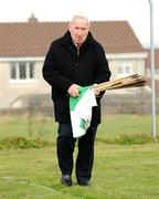 4 January 2009; Sean O'Connor, Claughaun club chairman, collects the flags after the game. Waterford Crystal Cup, Limerick v University of Limerick, Claughaun, Limerick. Picture credit: Diarmuid Greene / SPORTSFILE