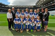 9 August 2015; President of the INTO Emma Dineen, Uachtarán Chumann Lúthchleas Gael Aogán Ó Fearghail, President of the Camogie Association Catherine Neary, President of Cumann na mBunscoil Maireád O'Callaghan, with the Waterford camogie team, back row, left to right, Ellen Regan, Crinkill NS, Birr, Offaly, Caolfhionn Ní Mhuilleoir, Gaelscoil Uí Fiach, Maigh Nuad, Cill Dara, Emer O'Donnell, St. Patrick's Girls, Carndonagh, Donegal, Lucy O'Kane, St. John's PS, Coleraine, Derry, Gráinne O'Reilly, Emo NS, Portlaoise, Laois, front row, left to right, Christine Shanahan, Scoil Olaf, Dundrum, Dublin, Jessica Halley, Fenor NS, Tramore, Waterford, Lauren Kelly, St. Bernard's NS, Abbeylara, Longford, Aoife Gray, Stonepark NS, Stonepark, Longford, Cora Kenny, New Inn NS, Ballinasloe, Galway, before the Cumann na mBunscol INTO Respect Exhibition Go Games 2015 at Kilkenny v Waterford - GAA Hurling All-Ireland Senior Championship Semi-Final. Croke Park, Dublin. Picture credit: Dáire Brennan / SPORTSFILE