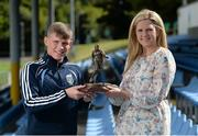 11 August 2015; UCD's Ryan Swan is presented with his SSE Airtricity player of the month award for July 2015 by Leanne Sheill, from Airtricity. Belfield Bowl, Belfield, UCD, Dublin. Picture credit: Seb Daly / SPORTSFILE