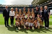 9 August 2015; Uachtarán Chumann Lúthchleas Gael Aogán Ó Fearghail, President of the INTO Emma Dineen, President of the Camogie Association Catherine Neary, President of Cumann na mBunscoil Maireád O'Callaghan with the Kilkenny hurling team, back row, from left, Ian Byrne, Glenmore NS Kilkenny, Ronan Donnelly, St. Patrick's PS, Donaghmore, Tyrone, Conor Burke, St Mark's SNS, Springfield, Dublin, Gerard Kavanagh, Myshall NS, Carlow, Seán Magill, Scoil Mhuire na nGael, Dundalk, Louth. Front row from left, Oisín Ó Ceallaigh, Gaelscoil Eoghan Uí Thuairisc, Carlow, Charlie Hamilton, St, Joseph's NS, Dromahair, Leitrim, Peter Doyle, St. Felim's NS, Ballinagh, Cavan, Thomas Lonergan, Dunboyne SNS, Meath, Ryan Devlin, Blessed Patrick O'Loughran, Dungannon, Tyrone. Cumann na mBunscol INTO Respect Exhibition Go Games 2015 at Kilkenny v Waterford - GAA Hurling All-Ireland Senior Championship Semi-Final. Croke Park, Dublin. Picture credit: Piaras Ó Mídheach / SPORTSFILE
