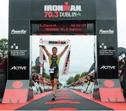 9 August 2015; Denis Chevrot, France, fought off stiff competition to take the gold medal at today's inaugural IRONMAN 70.3 Dublin. Dublin City Council hosted the competition which saw over 2500 athletes complete a 1.2 mile swim in Scotsman's Bay in Dun Laoghaire, before mounting their bikes to travel through Dublin and west of the city for a 56 mile cycle, to return to the Phoenix Park for the 13.1 mile half-marathon. 1,500 Irish athletes took part in today's event and 1,000 international athletes from 40 countries travelled to Dublin to compete in the gruelling competition. Chesterfield Avenue, Phoenix Park, Dublin. Picture credit: David Maher / SPORTSFILE
