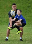 12 August 2015; Leinster Rugby player Noel Reid is beaten to the ball by a participant at the Bank of Ireland Summer Camp in De La Salle Palmerston F.C, Glenamuck North, Co. Dublin. Picture credit: Sam Barnes / SPORTSFILE