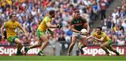 8 August 2015; Aidan O'Shea, Mayo, on his way to scoring his side's first goal despite the attention of Donegal players, from left, Hugh McFadden, Neil McGee and Ryan McHugh. GAA Football All-Ireland Senior Championship Quarter-Final. Donegal v Mayo, Croke Park, Dublin. Picture credit: Stephen McCarthy / SPORTSFILE