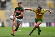 8 August 2015; Seamus O'Shea, Mayo, in action against Michael Murphy, Donegal. GAA Football All-Ireland Senior Championship Quarter-Final. Donegal v Mayo, Croke Park, Dublin. Picture credit: Stephen McCarthy / SPORTSFILE
