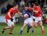 18 January 2009; John McGrath, Wicklow, in action against Ronan Carroll, left and Padraig Rath, Louth. O'Byrne Cup Semi-Final, Louth v Wicklow, Drogheda, Co. Louth. Picture credit: Paul Mohan / SPORTSFILE