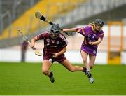 15 August 2015; Niamh McGrath, Galway, is tackled by Linda Bolger, Wexford. Liberty Insurance All-Ireland Camogie Senior Championship, Semi-Final, Galway v Wexford, Nowlan Park, Kilkenny. Picture credit: Sam Barnes / SPORTSFILE