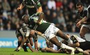 17 January 2009; Topsy Ojo, London Irish, is tackled by Kieran Campbell, Connacht. European Challenge Cup, Pool 1, Round 5, London Irish v Connacht, Madejski Stadium, Reading, England. Picture credit: Stephen McCarthy / SPORTSFILE