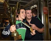 16 August 2015; Ireland gold medal winner Michael Conlan, Bantam weight, hoists his Best Boxer trophy alongside his father John Conlan at the Ireland team's homecoming from the EUBC Elite European Boxing Championships. Dublin Airport, Dublin. Picture credit: Cody Glenn / SPORTSFILE