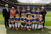 16 August 2015; Uachtarán Chumann Lúthchleas Gael Aogán Ó Fearghail, President of the INTO Emma Dineen, President of Cumann na mBunscoil Maireád O'Callaghan, with the Tipperary team, back row, left to right, Mikey Bergin, Golden NS, Cashel, Tipperary, Adam Donnelly, Mount Talbot NS, Roscommon, Aidan Connor, Ballybrown NS, Clarina, Limerick, Dara McGonigle, St. Canice's PS, Dungiven, Derry, front row, left to right, James Corcoran, St. Colmcille's, Templemore, Tipperary, Tom Matthews, Scoil Bhríde, Dunleer, Louth, Niall Duggan, St. Brigid's Maghera, Derry, x, Don Corrigan, St. Mary's PS, Killesher, Enniskillen, Fermanagh, Liam Doyle, Gaile NS, Holycross, Tipperary, Thomas Hughes, Castleblayney BNS, Monaghan before the Cumann na mBunscol INTO Respect Exhibition Go Games 2015 at Tipperary v Galway - GAA Hurling All-Ireland Senior Championship Semi-Final. Croke Park, Dublin. Picture credit: Ray McManus / SPORTSFILE