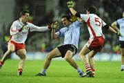 31 January 2009; Ger Brennan, Dublin, in action against Colin Holmes and Davy Harte, Tyrone. Allianz National Football League, Division 1, Round 1, Dublin v Tyrone, Croke Park, Dublin. Picture credit: Oliver McVeigh / SPORTSFILE