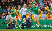 22 August 2015; Hannah Tyrrell, Ireland, runs clear to score her side's eighth try. Women's Sevens Rugby Tournament, Pool C, Ireland v Hong Kong. UCD, Belfield, Dublin. Picture credit: Seb Daly / SPORTSFILE