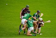 22 August 2015; Daniel Nevin, supported by his Galway team mate Shane Cooney, releases the sliothar unnder pressure from Limerick players Darragh O'Donovan, 8, Colin Ryan, 13, and Tom Morrisey. Bord Gáis Energy GAA Hurling All Ireland U21 Championship, Semi-Final, Limerick v Antrim. Semple Stadium, Thurles, Co. Tipperary. Picture credit: Ray McManus / SPORTSFILE
