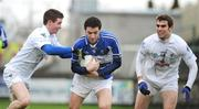 1 February 2009; Cathal Ryan, Laois, in action against Eoghan O'Flaherty, left, and Willie Heffernan, Kildare. Allianz GAA National Football League, Division 2, Round 1, Laois v Kildare. O'Moore Park, Portlaoise, Co. Laois. Picture credit: Stephen McCarthy / SPORTSFILE