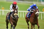 23 August 2015; Cailin Mor, left, with Sean Corby up, race alongside Chillie Billie, with Ross Coakley up, who finished second, on their way to winning the Luke & Nellie Comer Apprentice Handicap. Horse Racing from the Curragh. Curragh, Co. Kildare. Picture credit: Cody Glenn / SPORTSFILE