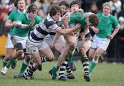 12 February 2009; Daniel Diviney, Gonzaga College, is tackled by Colly O'Shea, Greg Slattery and Enda McCarthy, Belvedere College. Leinster Schools Senior Cup 2nd Round, Belvedere College v Gonzaga College. Stradbrook Road, Dublin. Picture credit: Matt Browne / SPORTSFILE