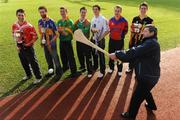9 February 2009; AIB Bank General Manager Billy Finn shows off his hurling skills during a photocall ahead of the AIB GAA Football and Hurling Junior and Intermediate Club Championship Finals in front of, from left, John Hughes, Blarney, Cork, John McDermott, John Mitchells, Liverpool, Stephen O'Sullivan, Skellig Rangers, Kerry, Kieran Granfield, St. Michaels Foilmore, Kerry, Greg Rogan, St. Michaels, Galway, Diarmuid O'Riordan, Dripsey, Cork, and Pat Hartley, Tullogher Robereen, Kilkenny. Croke Park, Dublin. Picture credit: Pat Murphy / SPORTSFILE