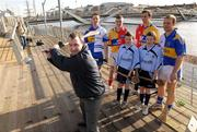 10 February 2009; Karl Manning, Director of Retail Sales at Halifax, tries out his hurling skills as hurlers, from left, Monaghan's Michael McHugh, Louth's Brian McCabe, Clare's Tony Griffin and Tipperary's Diarmuid Fitzgerald look on with twins Patrick and Simon O'Reilly, from Our Ladys National School, Balinteer, at todays announcement of plans for the 2009 Halifax GPA Hurling Twinning Programme.  The scheme will be expanded over the next twelve months with increased squad visits following the success of last year's inaugural programme. Clarion Hotel, IFSC, Dublin. Picture credit: Paul Mohan / SPORTSFILE