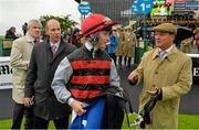 23 August 2015; Jockey Sean Corby with Trainer Michael Halford after riding Cailin Mor to victory in The Luke & Nellie Comer Apprentice Handicap. Curragh, Co. Kildare. Picture credit: Cody Glenn / SPORTSFILE