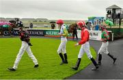 23 August 2015; Jockeys Donnacha O'Brien, from left, Dylan Hogan, Oisin Orr and Gary Phillips enter the parade ring before The Luke & Nellie Comer Apprentice Handicap. Horse Racing from the Curragh. Curragh, Co. Kildare. Picture credit: Cody Glenn / SPORTSFILE