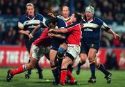 3 Novemeber 2000; Girvan Dempsey, Leinster is tackled by Munsters Anthoney Foley,left and John Kelly, right. Leinster v Munster, Guinness Interprovincial Rugby Championship, Donnybrook, Dublin. Picture credit; Brendan Moran/SPORTSFILE