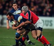 11 Novemeber 2000; Girvan Dempsey, Leinster is tackled by Munsters Killian Keane. Leinster v Munster, Guinness Interprovincial Rugby Championship, Donnybrook, Dublin. Picture credit; Brendan Moran/SPORTSFILE