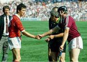 2 September 1990. Cork captain Tomas Mulcahy, left, shakes hands with Galway captain Joe Cooney in the presence of referee John Moore, Wateford. Cork v Galway, All-Ireland Hurling Final, Croke Park. Picture credit: Ray McManus/SPORTSFILE