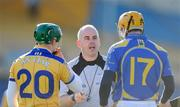 1 March 2009; Referee John Sexton has words with Conor McMahon, 20, Clare, and Lar Corbett, Tipperary. Allianz GAA National Hurling League, Division 1, Round 3, Tipperary v Clare, Semple Stadium, Thurles, Co. Tipperary. Picture credit: Brendan Moran / SPORTSFILE