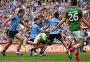 30 August 2015; Colm Boyle, Mayo, is tackled by Dublin players, Tomas Brady, Philip McMahon, Paul Flynn and Jack McCaffrey, resulting in a penalty being awarded by referee Joe McQuillian. GAA Football All-Ireland Senior Championship, Semi-Final, Dublin v Mayo, Croke Park, Dublin. Picture credit: David Maher / SPORTSFILE