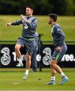 31 August 2015; Robbie Keane and Shane Long, Republic of Ireland, in action during squad training. Republic of Ireland Squad Training, Abbotstown, Co. Dublin. Picture credit: David Maher / SPORTSFILE