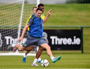 31 August 2015; Robbie Keane and Cyrus Christie, Republic of Ireland, in action during squad training. Republic of Ireland Squad Training, Abbotstown, Co. Dublin. Picture credit: David Maher / SPORTSFILE