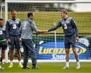 31 August 2015; Republic of Ireland manager Martin O'Neill shakes hands with James McClean, during squad training. Republic of Ireland Squad Training, Abbotstown, Co. Dublin. Picture credit: David Maher / SPORTSFILE