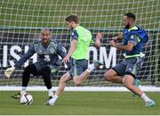 1 September 2015; Eunan O'Kane Republic of Ireland, in action against his team-mate's Marc Wilson and Darren Randolph, during squad training. Republic of Ireland Squad Training, Abbotstown, Co. Dublin. Picture credit: David Maher / SPORTSFILE