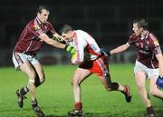 7 March 2009; Colin Holmes, Tyrone, in action against Joe Bergin, left, and Mark Lydon, Galway. Allianz GAA National Football League, Division 1, Round 3, Tyrone v Galway, Healy Park, Omagh, Co. Tyrone. Picture credit: Oliver McVeigh / SPORTSFILE
