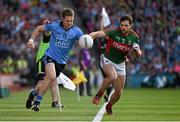 5 September 2015; Dean Rock, Dublin, tries to keep the ball in play, under pressure from Mayo's Ger Cafferkey, only for the linesman to signal is was indeed out. GAA Football All-Ireland Senior Championship Semi-Final Replay, Dublin v Mayo. Croke Park, Dublin. Picture credit: Ray McManus / SPORTSFILE