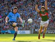 5 September 2015; Paddy Andrews, Dublin, scores a point in the 23rd minute despite the efforts of Ger Cafferkey, Mayo. GAA Football All-Ireland Senior Championship Semi-Final Replay, Dublin v Mayo. Croke Park, Dublin. Picture credit: Ray McManus / SPORTSFILE