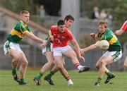 14 March 2009; Chris O'Donovan, Cork, in action against Tommy Walsh, left, Adrian Greaney, centre, and JB Spillane, Kerry. Cadbury Munster GAA Under 21 Football Championship, Cork v Kerry, Pairc Ui Rinn, Cork. Picture credit: Diarmuid Greene / SPORTSFILE