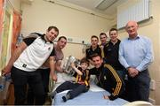 7 September 2015; Kilkenny hurlers, from left, Padraig Walsh, Ger Aylward, Cillian Buckley, Kieran Joyce, front, Joey Holden, Lester Ryan and manager Brian Cody with Sean Corr and the Liam MacCarthy Cup during a visit from the GAA Hurling All-Ireland Champions Kilkenny to Our Lady's Children's Hospital, Crumlin, Dublin. Picture credit: Stephen McCarthy / SPORTSFILE
