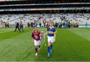 6 September 2015; Eanna Monaghan, left, age 10, from Turloughmore, Co. Galway, and Cian Connolly, age 10, from Nenagh, Co. Tipperary, carry the Irish Press cup out onto the pitch before the game. Electric Ireland GAA Hurling All-Ireland Minor Championship Final, Galway v Tipperary, Croke Park, Dublin. Picture credit: Diarmuid Greene / SPORTSFILE