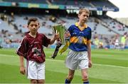 6 September 2015; Eanna Monaghan, left, age 10, from Turloughmore, Co. Galway, and Cian Connolly, age 10, from Nenagh, Co. Tipperary, carry the Irish Press cup off the pitch before the game. Electric Ireland GAA Hurling All-Ireland Minor Championship Final, Galway v Tipperary, Croke Park, Dublin. Picture credit: Diarmuid Greene / SPORTSFILE