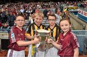 6 September 2015; Mascots bring out the Liam MacCarthy Cup before the game, left to right, Luke Lally, Menlough N.S., Co. Galway, Alex Walsh, Dunamaggin, Co. Kilkenny, Robert Ring, St. Joseph's N.S., Clinstown, Jenkinstown, Co. Kilkenny, and Michaela Gillooly, Williamstown N.S., Co. Galway. GAA Hurling All-Ireland Senior Championship Final, Kilkenny v Galway, Croke Park, Dublin. Picture credit: Ray McManus / SPORTSFILE