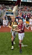 6 September 2015; Luke Lally, Menlough N.S., Co. Galway, and Alex Walsh, Dunamaggin N.S., Co. Kilkenny, carry out the Liam MacCarthy cup before the game. GAA Hurling All-Ireland Senior Championship Final, Kilkenny v Galway, Croke Park, Dublin. Picture credit: Ray McManus / SPORTSFILE