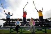 25 March 2009; Uachtaran Chumann Camogaiochta na Gael Liz Howard with Na Fianna Camogie Club players, from left, Amy McCarville, Ellen Healy and Sarah Montgomery at the launch of 'Caman Get A Grip' and 'Caman Get Hooked' Foundation and Level 1 Coaching Education Courses. Croke Park, Dublin. Picture credit: Pat Murphy / SPORTSFILE