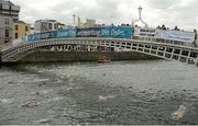 19 September 2015; Female competitors swim under the Ha'Penny Bridge while taking part in the Dublin City Liffey Swim. Dublin City Liffey Swim. Dublin. Picture credit: Cody Glenn / SPORTSFILE